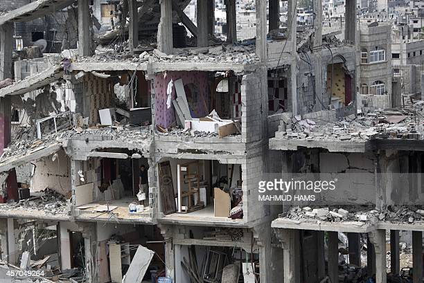 A Palestinian man stands at a room of a destroyed building in alTufah east of Gaza City on October 11 ahead of a donors conference in Cairo aimed at...
