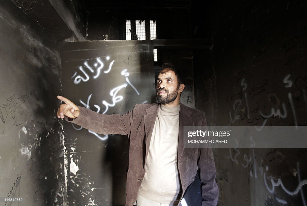 A Palestinian man visits a building which used to be an Israeli prison to keep Palestinians during Israel's occupation of Gaza, on April 11, 2013, as part of a tour organized by Hamas to show the facility that has now turned into a memorial center, in Gaza City. Israel has evacuated its settlements and army posts in the Gaza Strip in 2005 .