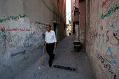 A Palestinian man walks at the alFawwar refugee camp south of the West Bank city of Hebron on July 26 2016 Israel reopened the main entrance to the...