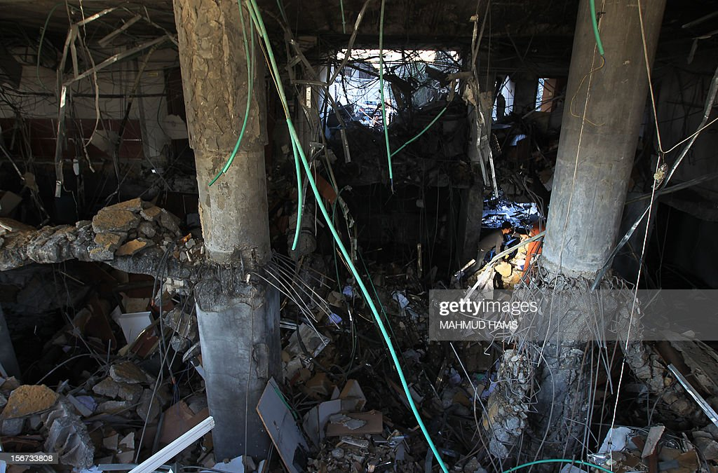 A Palestinian man walks inside the a branch of the destroyed Islamic National Bank following an Israeli air strike in Gaza City, on November 20, 2012. Seven Palestinians were wounded in strikes on Gaza overnight, but no one was killed in the first night without fatalities since the Israeli air campaign began nearly a week ago.