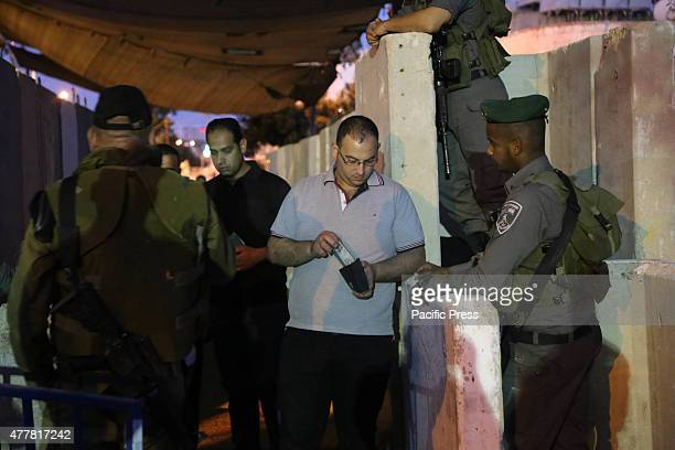 Palestinian man walks through Bethlehem checkpoint as Palestinians wait to show their identity cards to Israeli security officers to make their way...