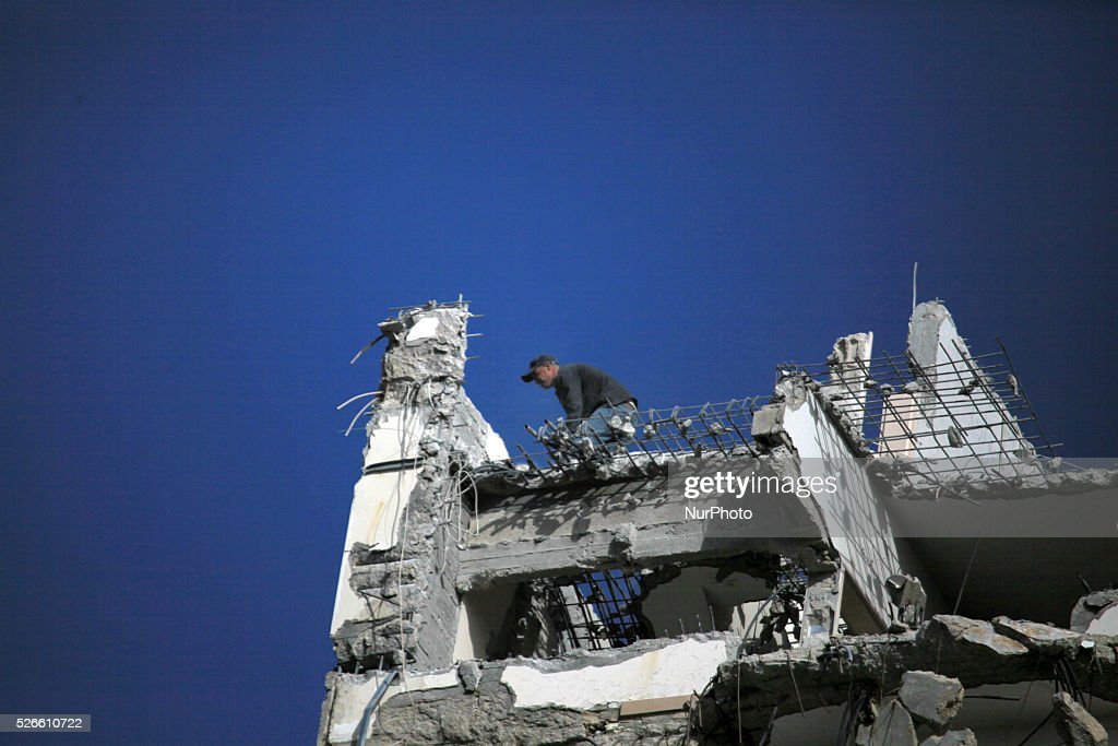A Palestinian man work on the remains of a building destroyed during the recent Israeli war 2014, in Gaza city, on April 30, 2016. Israels punitive ban on cement imports into the Gaza Strip has prevented hundreds of families from rebuilding their homes devastated by the 2014 war, the UN Office for the Coordination of Humanitarian Affairs (OCHA) said in a press release Thursday.