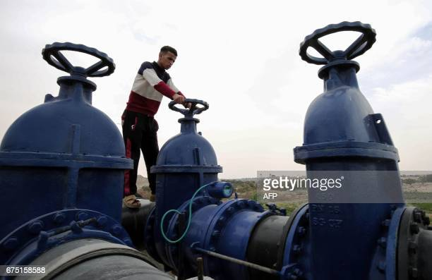 A Palestinian man works at the Rafah water waste treatment plant in the southern Gaza Strip on April 30 as Gazans continue to suffer from severe...