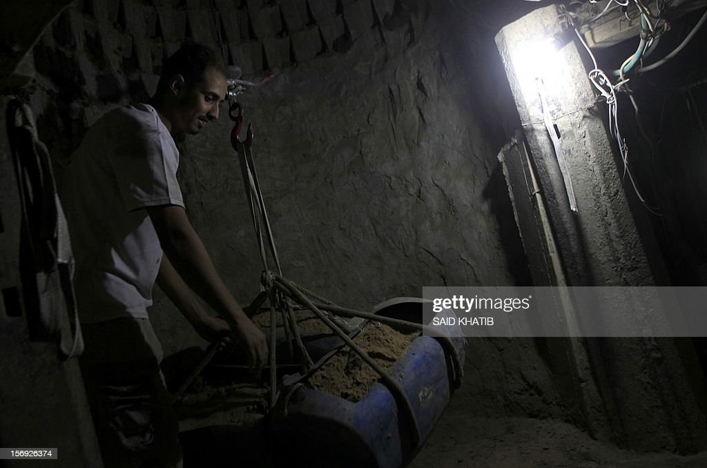 A Palestinian man works inside a smuggling tunnel along the Gaza-Egypt border in Rafah, in the southern Gaza Strip on November 25, 2012. Egypt's closure of scores of cross-border smuggling tunnels has affected the flow of goods into Gaza but has not dealt the knockout blow widely expected by traders and officials.