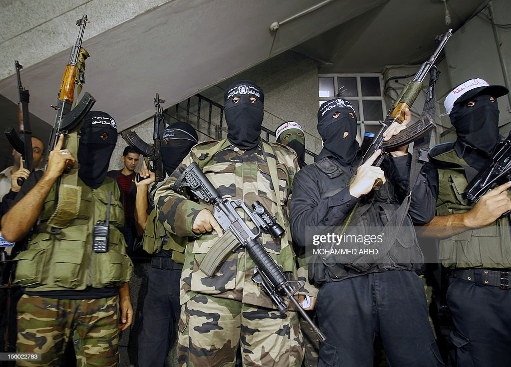 Palestinian masked gunmen, belonging to the Popular Resistance Committees (PRC), attend a press conference in Gaza City on November 11, 2012. The outbreak of violence was one of the most serious since Israel's devastating 22-day operation in the Gaza Strip over New Year 2009, and raised the spectre of a broad Israeli operation against the Palestinian territory.