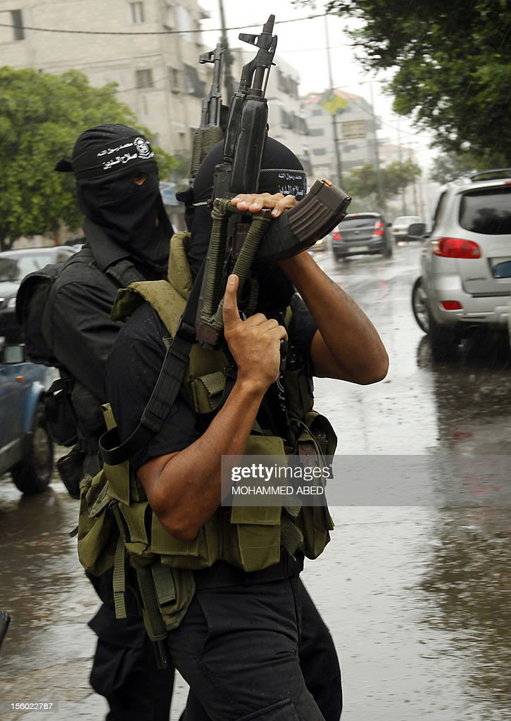 Palestinian masked gunmen, belonging to the Popular Resistance Committees (PRC), leave a press conference in Gaza City on November 11, 2012. The outbreak of violence was one of the most serious since Israel's devastating 22-day operation in the Gaza Strip over New Year 2009, and raised the spectre of a broad Israeli operation against the Palestinian territory.