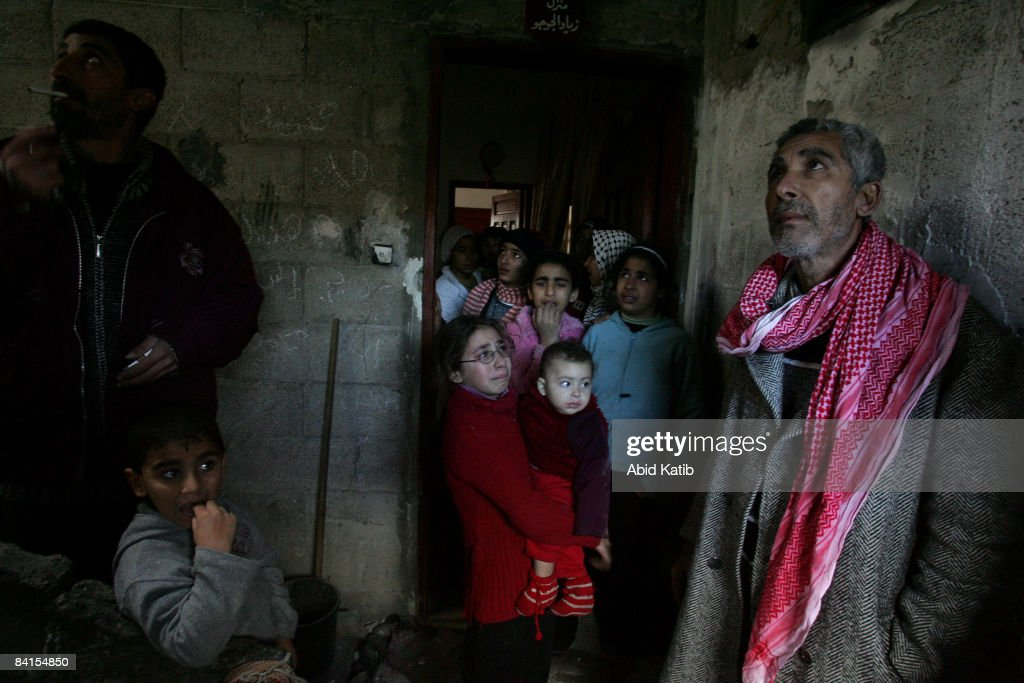 Palestinian members of Al-jojo family before they leave their home after an Israeli F-16 warplane strike that destroyed the neighbouring houses on January 1, 2009 in Gaza, Gaza Strip. Israeli warplanes attacked government buildings in the Gaza Strip on New Year's Day after Israel and its Islamist Hamas foe both spurned ceasefire calls in a conflict that has killed around 400 Palestinians and injured around 1,600.
