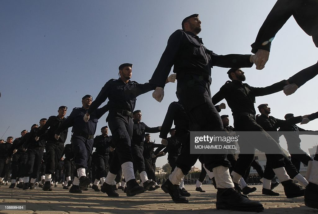 Palestinian members of Hamas' national security forces march during a parade as part of a graduation ceremony in Gaza City on January 3, 2013.