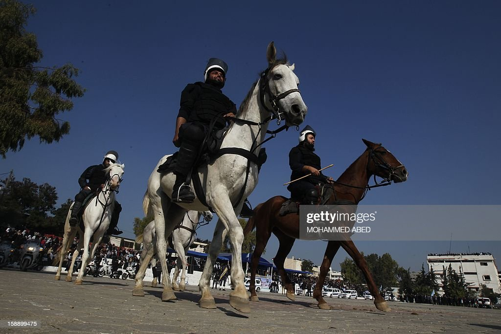 Palestinian members of Hamas' national security forces ride horses during a graduation ceremony in Gaza City on January 3, 2013.