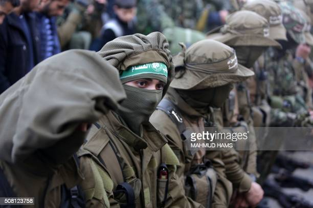 TOPSHOT Palestinian members of the Ezzedine alQassam Brigades the armed wing of the Hamas movement mourn during the funeral of fellow militant Ahmed...