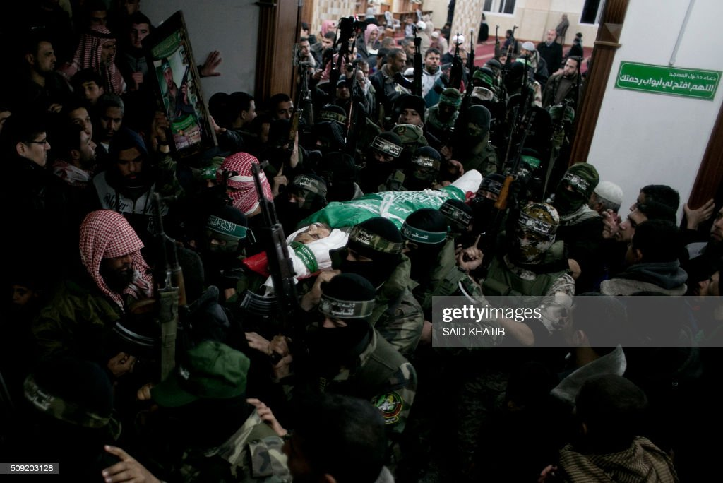 Palestinian members of the Ezzedine al-Qassam Brigades, the armed wing of the Hamas movement carry the body of their comrade Marwan Maarouf, 27, during his funeral in Khan Yunis in the southern Gaza Strip, on February 9, 2016. Maarouf was killed when a tunnel collapsed in the Gaza Strip, Hamas said, in the fourth such incident over the past few weeks. The death brings to 11 the number of Gazans killed in four separate collapses since January 26, and comes with Israeli concern building over the reconstruction of tunnels it says could be used for attacks. / AFP / SAID KHATIB