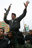Palestinian members of the Fatah group march during a protest to demand jobs in the Palestinian security forces in Gaza City 18 February 2007 US...