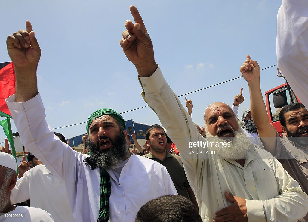 Palestinian men chant slogans during a demonstration in Gaza city on June 7, 2013, calling for an end to Israeli occupation of Palestine. The Israeli navy has arrested two Palestinian fishermen off the coast of the Hamas-ruled Gaza Strip, sources on both sides said.
