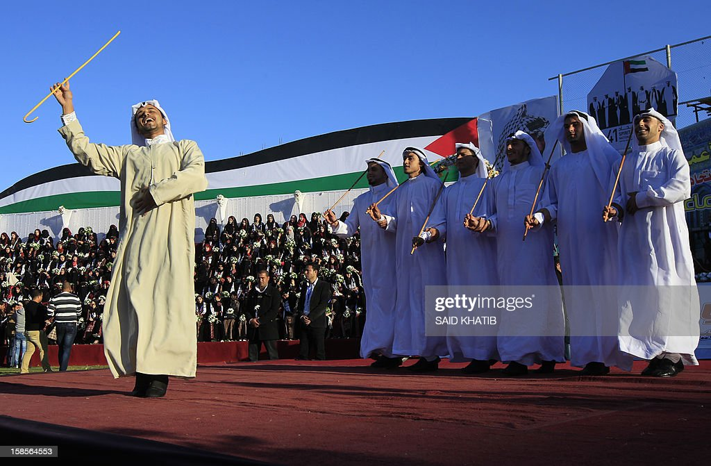 Palestinian men dressed in traditional garbs perform a dance during a mass wedding ceremony in Rafah, southern Gaza Strip, on December 19, 2012. Some 436 couples in need participated to the mass wedding organized by the National Islamic Committee in the Gaza Strip and other financial donations.