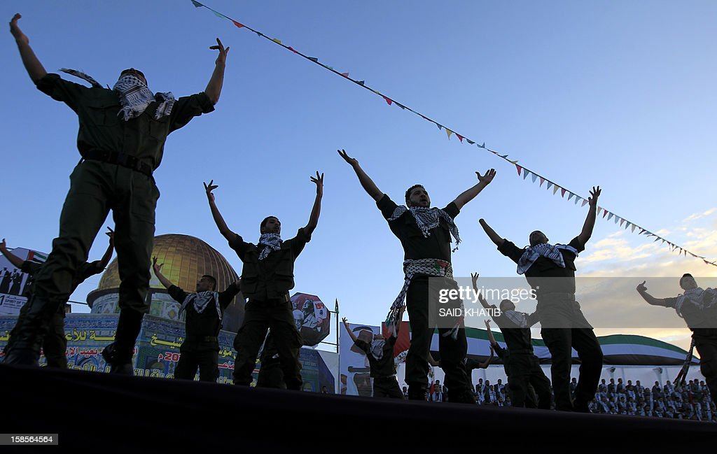 Palestinian men perfom a dance during a mass wedding ceremony in Rafah, southern Gaza Strip, on December 19, 2012. Some 436 couples in need participated to the mass wedding organized by the National Islamic Committee in the Gaza Strip and other financial donations.