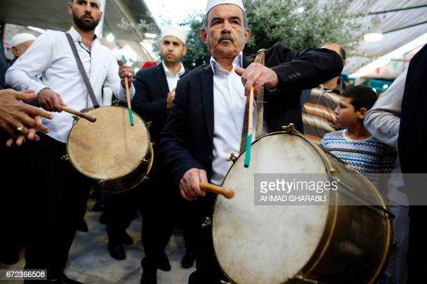 Palestinian men play drums during a ceremony commemorating the Prophet Mohammed's ascent to heaven known in Arabic as Isra and Miraj in the Old City...