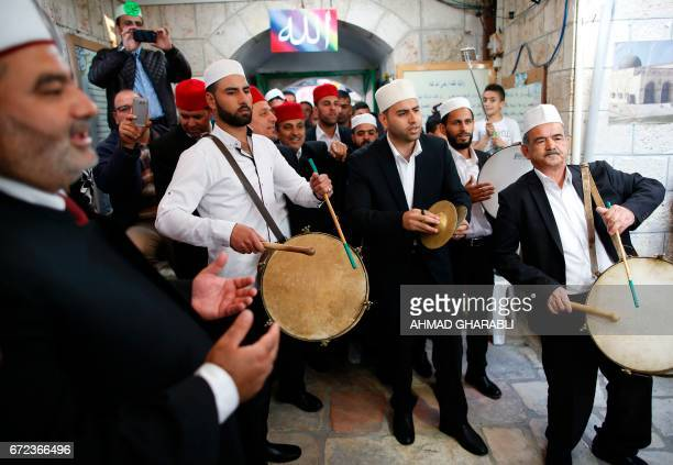 Palestinian men play music during a ceremony commemorating the Prophet Mohammed's ascent to heaven known in Arabic as Isra and Miraj in the Old City...
