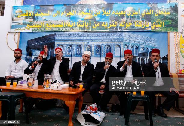 Palestinian men sing during a ceremony commemorating the Prophet Mohammed's ascent to heaven known in Arabic as Isra and Miraj in the Old City of...