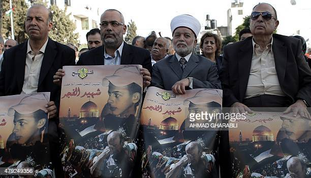 Palestinian men take part in a demonstration in Shuafat in Israel annexed East Jerusalem on July 2 2015 to mark the first anniversary of the killing...