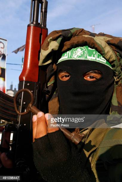 Palestinian militant from Izz alDin alQassam Brigades of Hamas holds a key during the marking of Nakba or the ''Day of Catastrophe'' in Rafah in the...