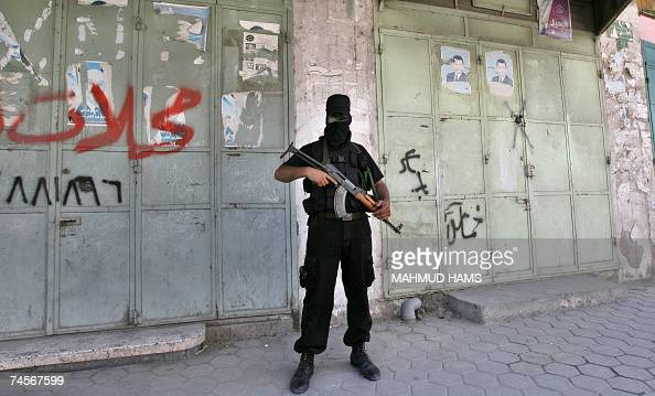 Palestinian militant of Hamas radical Islamist movement stands in front of closed shops in Gaza City 12 June 2007 Gunmen from Hamas staged attacks on...