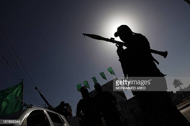 A Palestinian militant of the Ezzedine alQassam brigade the armed wing Hamas stands guard as they prepare for the arrival of the Islamist movement's...