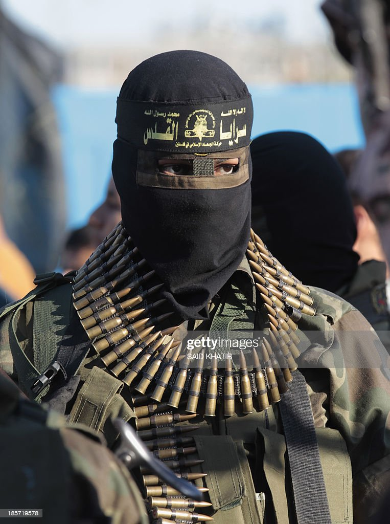 A Palestinian militant of the Islamic Jihad takes part in a rally against Israel in the southern Gaza Strip town of Rafah, on October 24, 2013. AFP PHOTO/ SAID KHATIB