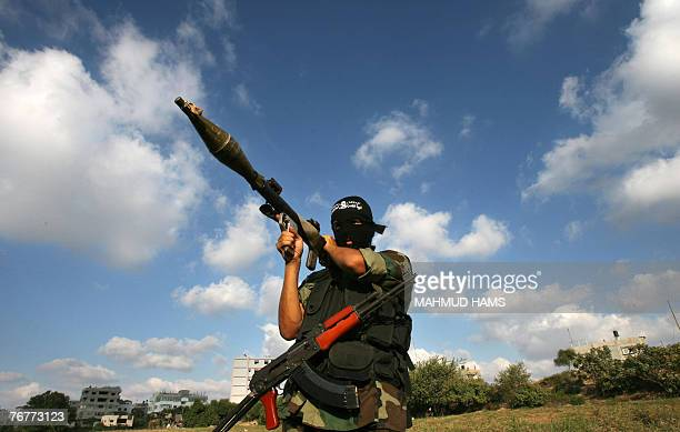 A Palestinian militant of the Popular Resistance Committee holds a rocket propelled grenade during an armed exercise in Gaza City 15 September 2007...