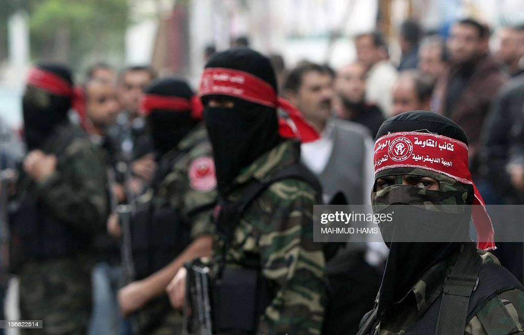 Palestinian militants from the Democratic Front for the Liberation of Palestine (DFLP) stand guard during the funeral of Mohammed Aiash, a member of the grassroots activist movement known as the Popular Struggle Committees, in Gaza City on November 22, 2012. The activist was killed the previous day, just as an Egypt-brokered truce took hold in the Gaza Strip, ending eight-day operation during which the Israeli army said it hit more than 1,500 targets, while Gaza militants fired 1,354 rockets over the border.