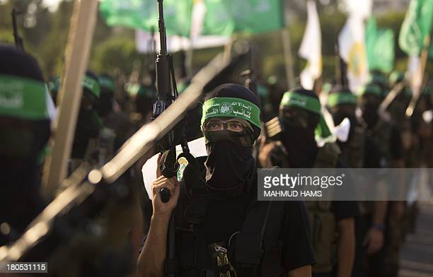 Palestinian militants from the Ezzedine alQassam brigade the armed wing of Hamas take part in a march in Gaza City on September 14 2013 AFP PHOTO /...