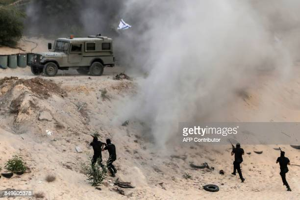 Palestinian militants of alNasser Salah alDeen Brigades the military wing of the Popular Resistance Committees pretend to fight with mock Israeli...