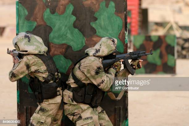 TOPSHOT Palestinian militants of alNasser Salah alDeen Brigades the military wing of the Popular Resistance Committees take part in a training...