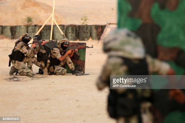 Palestinian militants of alNasser Salah alDeen Brigades the military wing of the Popular Resistance Committees take part in a training exercise in...