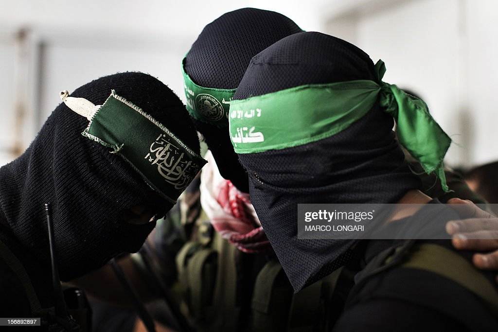 Palestinian militants of Hamas' armed wing, the Ezzedine al-Qassam Brigades, mourn at the funeral procession of one of their leaders, Judah Shamallah, in Gaza City on November 24, 2012, who died overnight from injuries he endured from the week-long confrontation between Israel and Gaza militants. A ceasefire came into effect on November 21, in and around Gaza after a week of cross-border violence that killed at least 160 people.