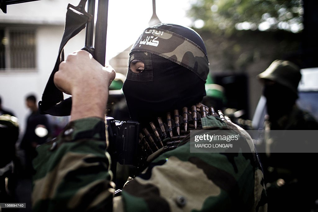 Palestinian militants of Hamas' armed wing, the Ezzedine al-Qassam Brigades, attend the funeral procession of one of their leaders, Judah Shamallah, in Gaza City on November 24, 2012, who died overnight from injuries he endured from the week-long confrontation between Israel and Gaza militants. A ceasefire came into effect on November 21, in and around Gaza after a week of cross-border violence that killed at least 160 people.