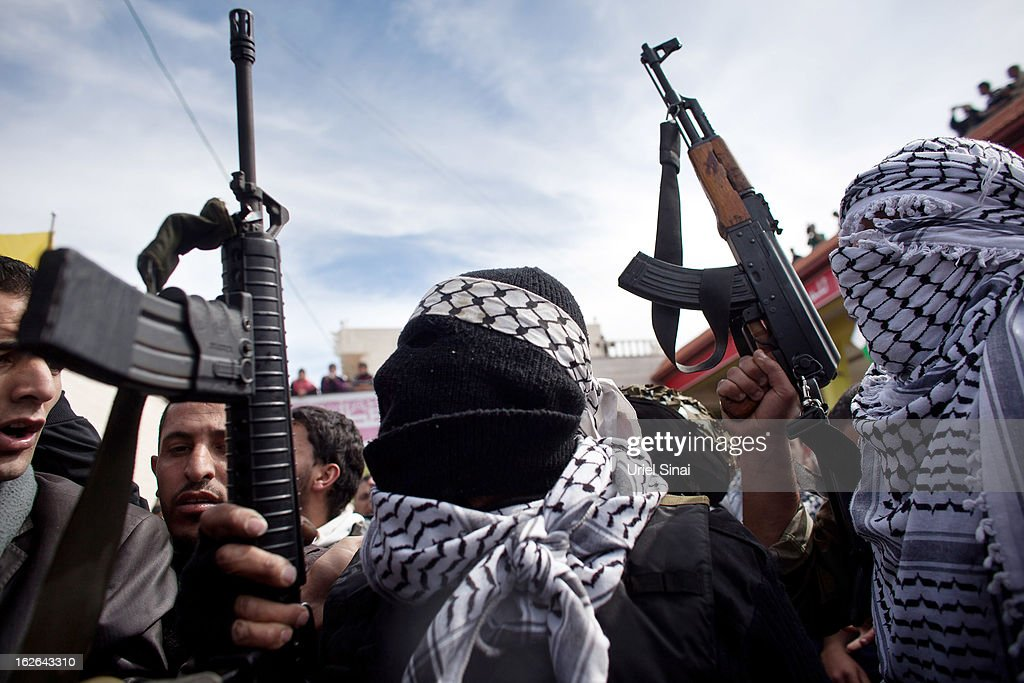 Palestinian militants of the Al-Aqsa Martyrs Brigades take part in the funeral of Arafat Jaradat on February 25, 2013 in the village of Saair in the West Bank. According to reports, Jaradat died while in Israeli custody under disputed circumstances, with Palestinian officials saying an autopsy showed he was tortured.