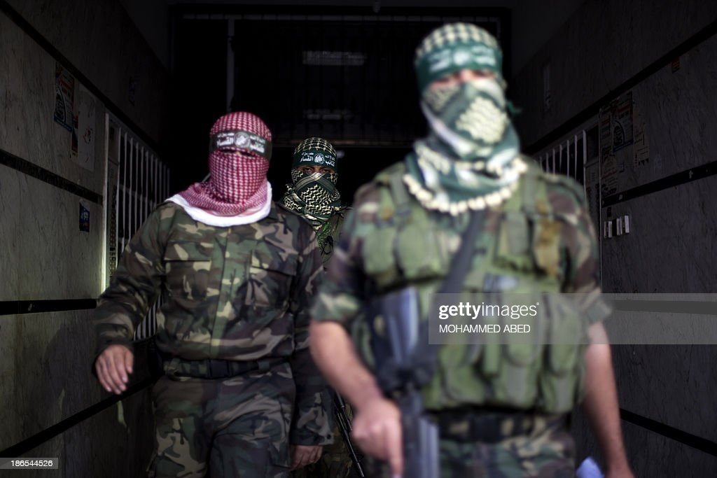 Palestinian militants of the Hamas' armed wing, Ezzeddine al-Qassam Brigades, leave following a press conference in Gaza City, on November 1, 2013.