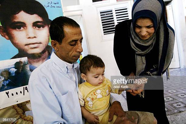 Palestinian mother Amal alDurra and father Jamal carry their ninemonthold child Mohammed who given the same name of his brother Mohammed alDurra who...