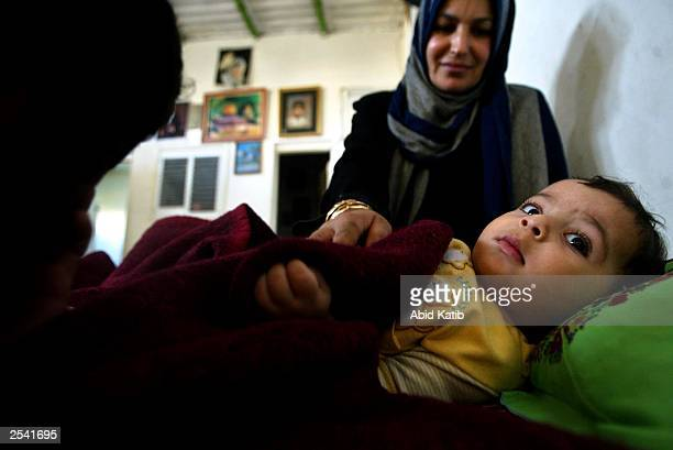 Palestinian mother Amal alDurra tries to put to sleep her ninemonthold child Mohammed who given the same name of his brother of 12yearold Mohammed...