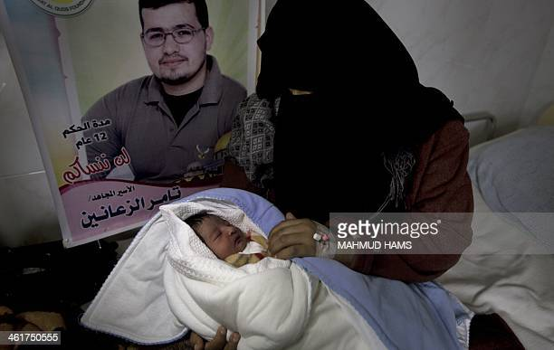 Palestinian mother Hanaa alZanen holds her new born baby boy who was conceived with sperm from her husband smuggled out of an Israeli prison at a...