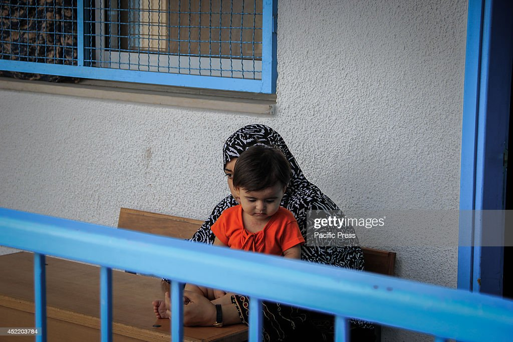A Palestinian mother is pampering her child in one of UNRWA schools which lately became the only refuge for tens of Palestinian families who escaped from North Gaza as a result of Israeli aggression. The Palestinian MNO said that since tha last 8 days of the Israeli Aggression on Gaza strip there were 193 martyrs ,more than 1500 injured, and 600 house and mosque were completely destroyed.