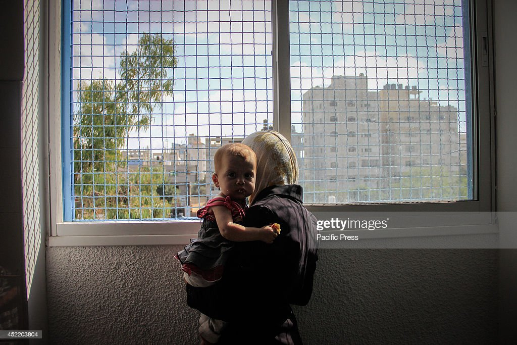 A Palestinian mother looks out the window one of the UNRWA schools, which recently became the only refuge for dozens of Palestinian families who fled from the northern Gaza Strip as a result of the Israeli aggression. He said that since the Palestinian MNO 8 tha last days of the Israeli aggression on the Gaza Strip, there were 193 martyrs, and more than 1,500 wounded, and 600 houses and a mosque were destroyed completely.