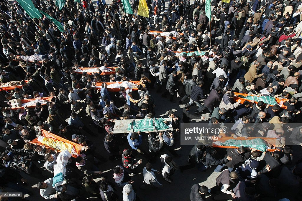 Palestinian mourners attend on January 7 2009 the funeral of 43 victims from an Israeli strike on a UN school in Gaza yesterday during their funeral...
