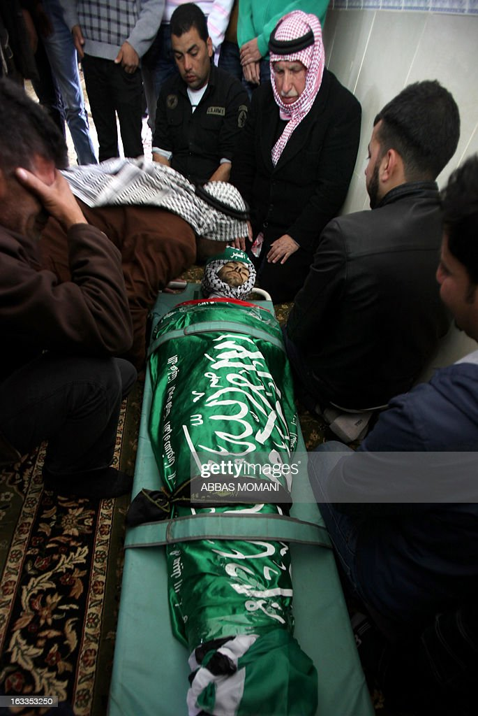 Palestinian mourners bid farewell to Mohammad Asfour, a 22-year-old protester who died of wounds sustained the previous day, during his funeral in the West Bank village of Abud on March 8, 2013. Asfour was wounded in the head by a rubber-coated steel bullet fired by Israeli troops during a protest which erupted after a prisoner died in Israeli custody.