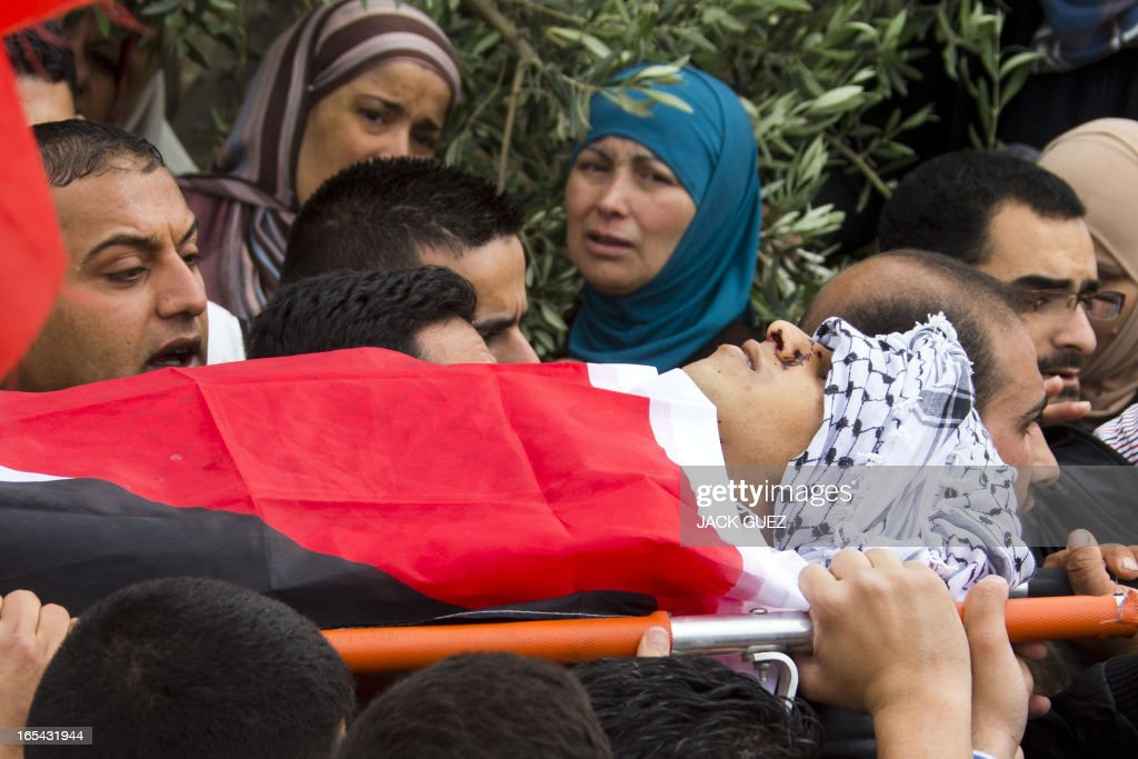 Palestinian mourners carry the body of Amer Nasser, a 17-year-old shot by Israeli troops, during his funeral in the West Bank town of Anabta near Tulkarem on April 4, 2013. The West Bank simmered with anger as thousands joined the funeral of prisoner Maisara Abu Hamdiyeh who died in an Israeli jail and similar numbers gathered to bury two teens shot dead overnight during clashes over the death of the prisoner, Israeli and Palestinian sources said.