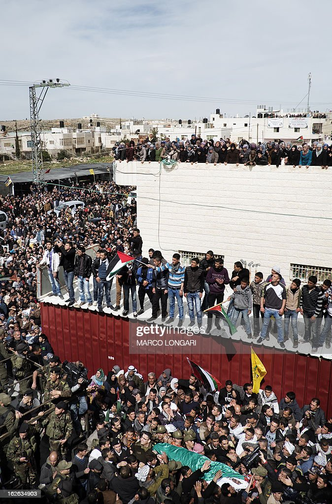 Palestinian mourners carry the body of Arafat Jaradat, an inmate who died in an Israeli prison, during his funeral in the West Bank village of Saair on February 25, 2013. Militants of the Al-Aqsa Martyrs Brigades, the armed wing of Palestinian president Mahmud Abbas' Fatah movement, vowed to avenge the death of Jaradat, a prisoner they say was tortured in an Israeli jail.