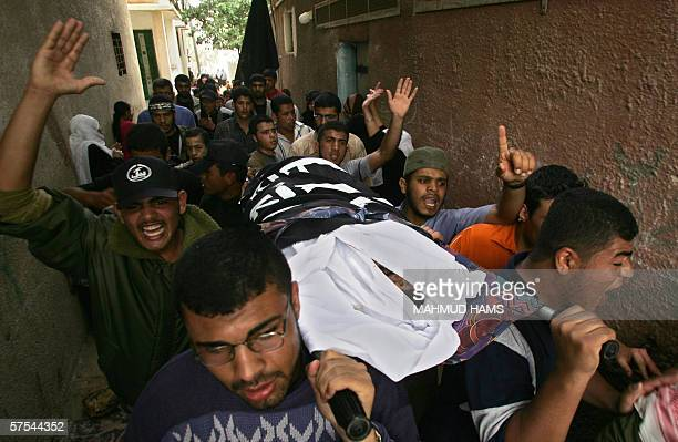 Palestinian mourners carry the body of Jumaa Doughmoush mourn during his funeral in Gaza City 06 May 2006 Dogmosh is one of five Palestinians who...