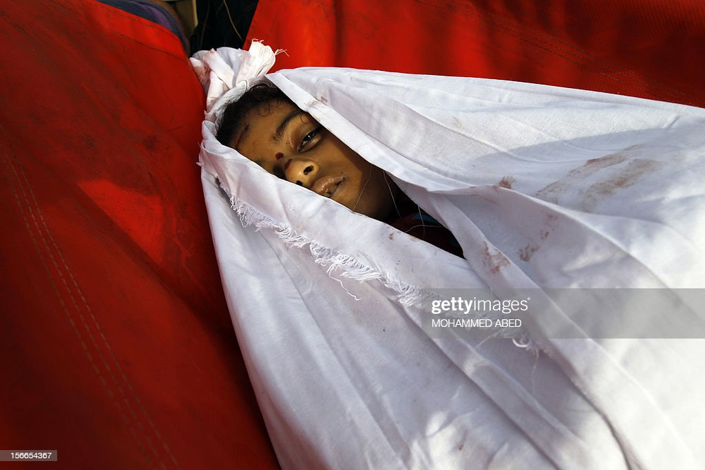 Palestinian mourners carry the body of Tasneem al-Nahal, 13, during her funeral in Gaza City on November 18, 2012. An Arab League delegation headed by the bloc's chief Nabil al-Arabi will visit Gaza on November 20, in a show of support for the territory in the face of Israeli air strikes, a league official said.
