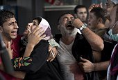 Palestinian mourners cry at Gaza City's alShifa hospital after an explosion killed at least seven children in a public playground in the beachfront...