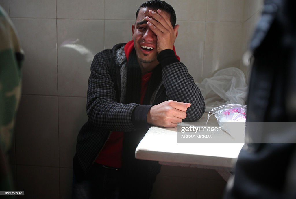 A Palestinian mourns over the death of Mohammed Asfour at a the hospital in Ramallah on March 7, 2013 after he succumbed to his injuries from clashes with Israeli troops during a protest in February which erupted following the death of a prisoner in Israeli custody. Asfour, a 22-year-old student studying sports, was seriously wounded by a rubber-coated steel bullet to the head fired by Israeli troops during a demonstration in the West Bank village of Abud on February 23, activists said. AFP PHOTO/ABBAS MOMANI